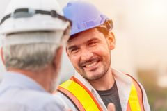 Smiling engineer happy to working together. Talking with business man royalty free stock photography