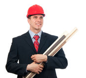Smiling engineer with hard hat and blueprints. Handsome smiling engineer with hard hat on his head and blueprints in his arms isolated on white Royalty Free Stock Images