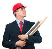 Smiling engineer with hard hat and blueprints Stock Photo