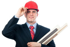 Smiling engineer with hard hat and blueprints. Handsome smiling engineer with hard hat on his head and blueprints in his arms isolated on white Royalty Free Stock Photo