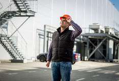Smiling engineer in hardhat posing on construction site Stock Photos