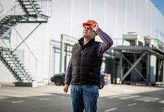 Smiling engineer in hardhat posing on construction site. Portrait of smiling engineer in hardhat posing on construction site Stock Photos