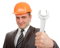 Smiling engineer in hardhat with spanner Royalty Free Stock Image