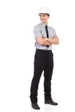 Smiling engineer looking away. Full length Royalty Free Stock Images