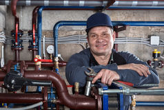Smiling engineer plumber. Stock Image