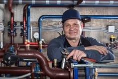 Smiling engineer plumber. Stock Image