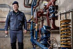 Smiling engineer plumber. Stock Photos