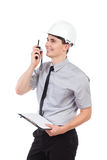 Smiling engineer and walkie talkie. Stock Image