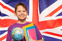 Smiling English student with globe and textbooks Royalty Free Stock Photography