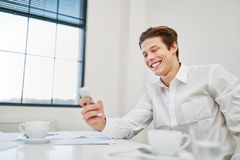 Smiling entrepreneur with smartphone Royalty Free Stock Images
