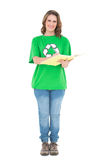 Smiling environmental activist writing Stock Images