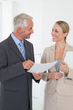 Smiling estate agent going over contract with customer Royalty Free Stock Image