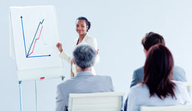 Smiling ethnic businesswoman doing a presentation Royalty Free Stock Image