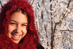 Smiling Ethnic Girl. A beautiful ethnic girl smiles as she enjoys a sunny winter's day. Room for copy royalty free stock photo