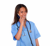 Smiling ethnic nurse woman speaking on phone Stock Photo
