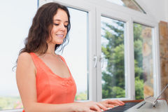 Smiling european girl having piano class in home Stock Photography
