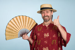 Smiling european in traditional chinese shirt Royalty Free Stock Photography