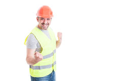 Smiling excited builder acting like a winner. And celebrating suuccess isolated on white studio background with text area Royalty Free Stock Photo