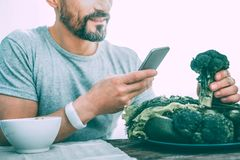 Smiling excited man making a photo of vegetables royalty free stock images