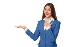 Smiling excited woman showing open hand palm with copy space for product or text. Business woman in blue suit, isolated over white. Background stock image