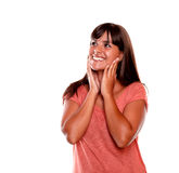 Smiling and excited young woman looking right Stock Photo