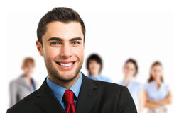Smiling executive in front of his team Stock Images