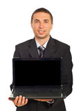Smiling executive man holding laptop Royalty Free Stock Photo