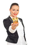Smiling executive with piggy bank in her hand Royalty Free Stock Photos