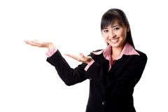 Smiling executive presenting with hands royalty free stock photo