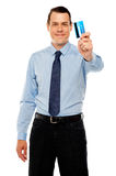 Smiling executive showing credit card Royalty Free Stock Image
