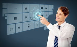 Smiling executive showing a virtual screen. Young business man pointing on futuristic virtual screen stock illustration