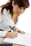Smiling executive signing on agreement Royalty Free Stock Image
