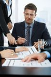 Smiling executive signing contract Royalty Free Stock Images