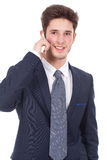 Smiling executive using cellphone Royalty Free Stock Photography