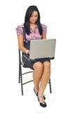 Smiling executive woman using laptop stock photography
