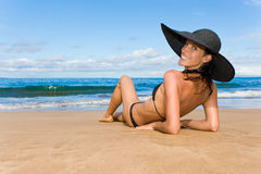 Smiling exotic woman beach. Elegant exotic woman smiling on tropical beach laying on sand Royalty Free Stock Photos