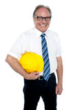 Smiling experienced architect posing with safety helmet Stock Images