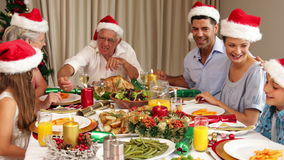 Smiling extended family at the christmas dinner table Royalty Free Stock Photography