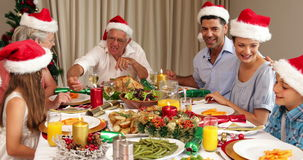 Smiling extended family at the christmas dinner table stock footage