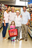 Smiling extended family at the supermarket Royalty Free Stock Photography