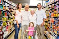 Smiling extended family at the supermarket Stock Image