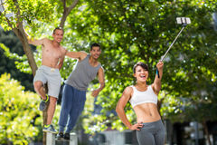 Smiling extreme athletes taking selfies with selfiestick royalty free stock photography