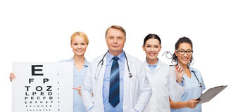 Smiling eye doctors and nurses Stock Photo