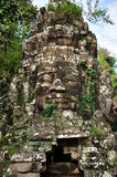 Smiling face in Angkor Wat Royalty Free Stock Photo