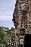 Smiling face in Angkor Wat. Angkor Wat in Siem Reap, Cambodia.Angkor Wat is the largest Hindu temple complex and the largest religious monument in the world Stock Photos
