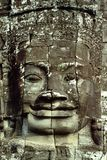 Smiling Face - Angkor Wat, Cambodia. The Bayon Temple of the Angkor Wat Archaeological Complex in Cambodia presents 54 towers decorated with 216 statues of Royalty Free Stock Images