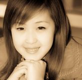 Smiling face of Asian girl Stock Images
