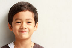 Smiling face of Asian young boy. Asian boy looking and smiling Royalty Free Stock Photo