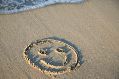 Smiling face on the beach Stock Image