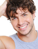 Smiling face of a beautiful caucasian man Stock Photos